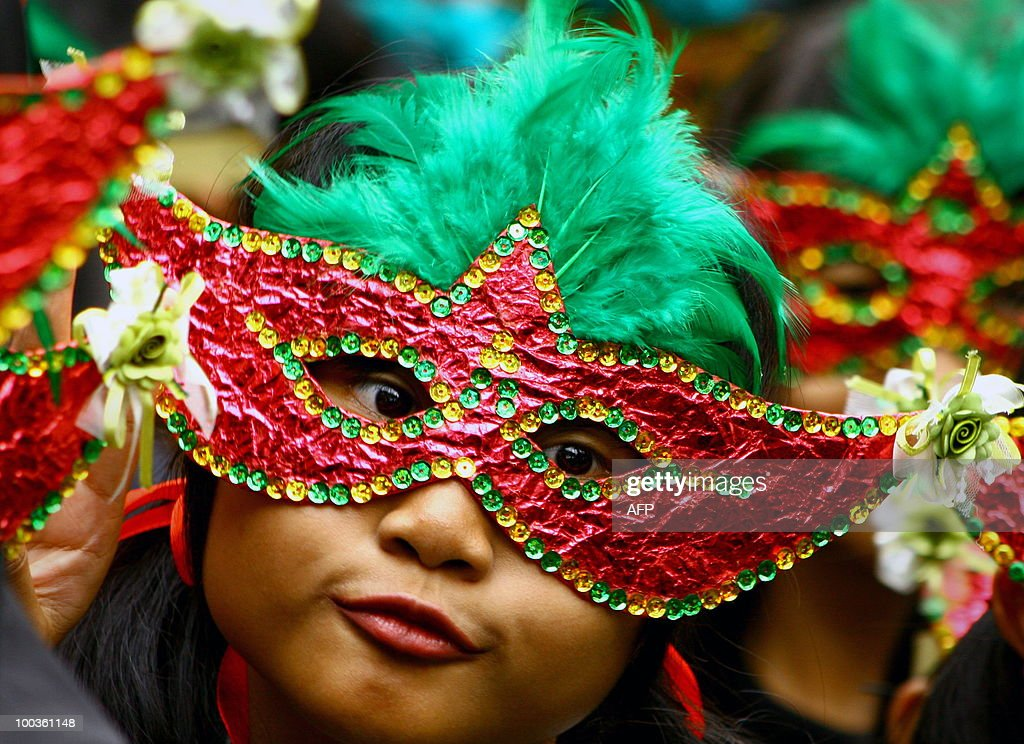This photo taken on May 23, 2010 Indonesian performers parade wearing masks during the traditional Topeng - or mask festival - in Malang, East Java province. Held in many parts of Indonesia, the highly popular masks festivities vary from modern colorful cutouts, papier-mache, and painted faces to the traditional woodcarvings symbolizing faces of spiritual figures that is largely part of ancient Javanese rituals.