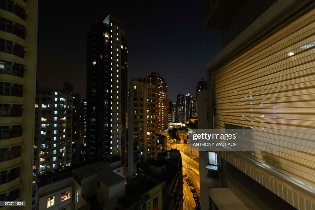 This photo taken on May 23, 2018, shows a general view from the studio apartment of finance worker Adrian Law, 25, for which he paid more than 765,000 USD two years ago in a new development in the gentrified Sai Ying Pun neighbourhood of Hong Kong. - As housing prices spiral in Hong Kong, young professionals are living in ever-shrinking spaces, with box-like 'nano-flats' and co-shares touted as fashionable solutions. (Photo by Anthony WALLACE / AFP)