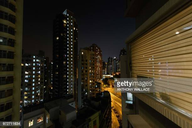 This photo taken on May 23 shows a general view from the studio apartment of finance worker Adrian Law for which he paid more than 765000 USD two...