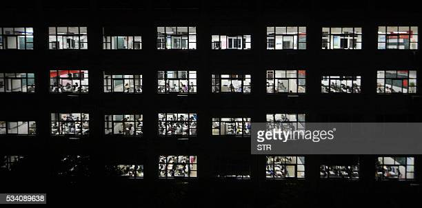 This photo taken on May 24 2016 shows senior high school students studying at night to prepare for the college entrance exams at a high school in...