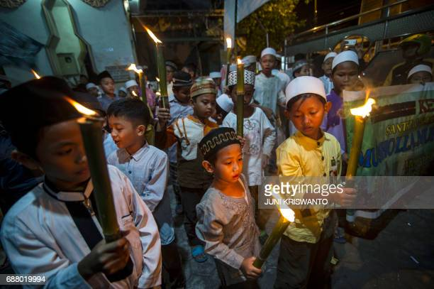 This photo taken on May 24 2017 shows Indonesian children taking part in a parade to welcome the Muslim holy fasting month of Ramadan in Surabaya...