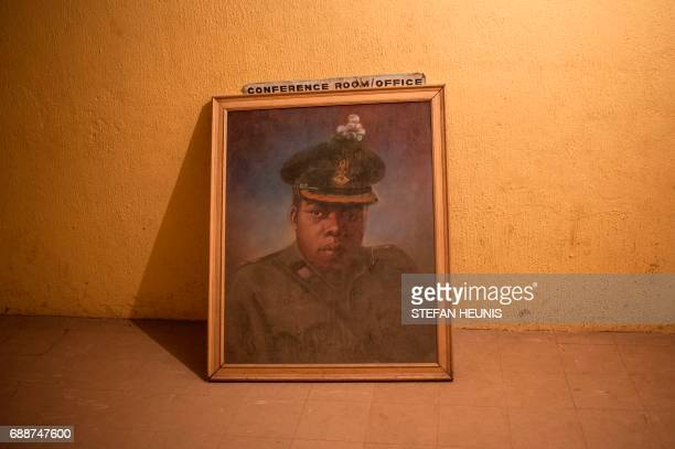 This photo taken on May 26 2017 in Umuahia southeast Nigeria a painting of General Chukwuemeka Odumegwu Ojukwu of Biafra placed on the floor of the...