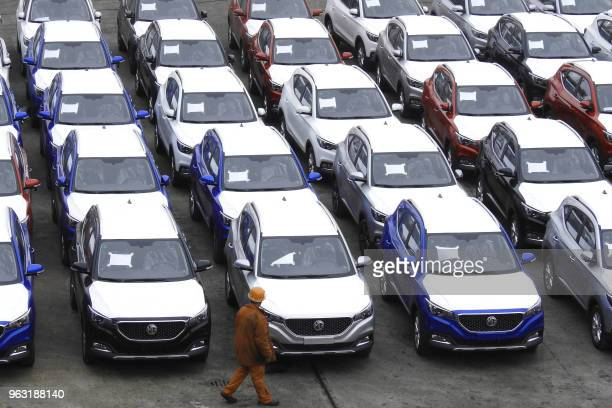This photo taken on May 26 2018 shows MG cars produced by SAIC Motor Corp waiting to be exported to the US at a port in Lianyungang in China's...
