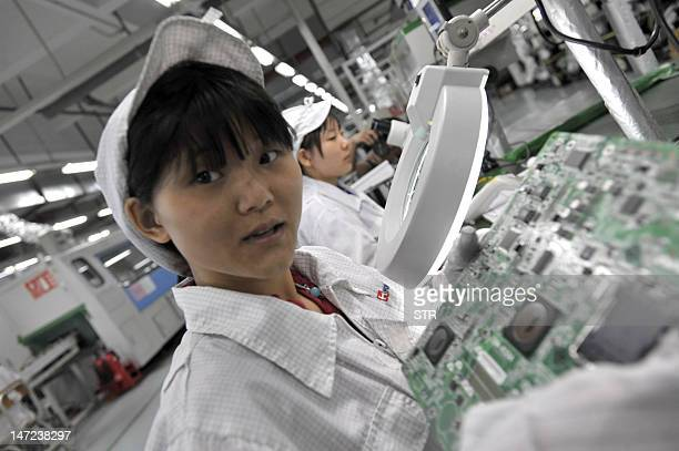 This photo taken on May 27 2010 shows Chinese workers in the Foxconn factory in Shenzhen in southern China's Guangdong province A labour rights group...