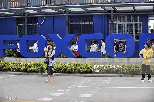 This photo taken on May 27 2010 shows Chinese workers outside the Foxconn factory in Shenzhen southern China's Guangdong province A labour rights...