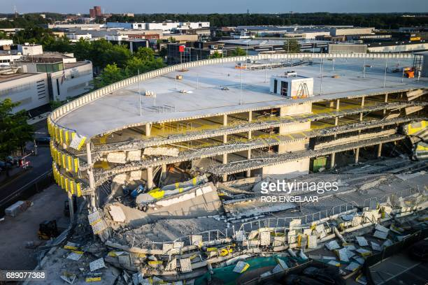 TOPSHOT This photo taken on May 27 2017 at the Eindhoven Airport shows a collapsed section of a parking garage There were no injures and cause of the...