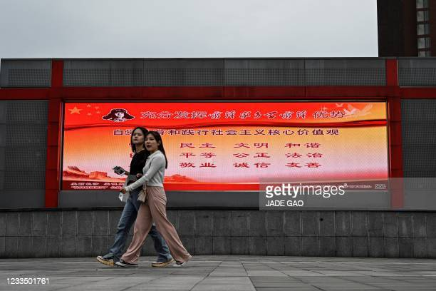 This photo taken on May 28, 2021 shows an outdoor screen displaying a propaganda slogan of socialist core values which reads prosperity, democracy,...