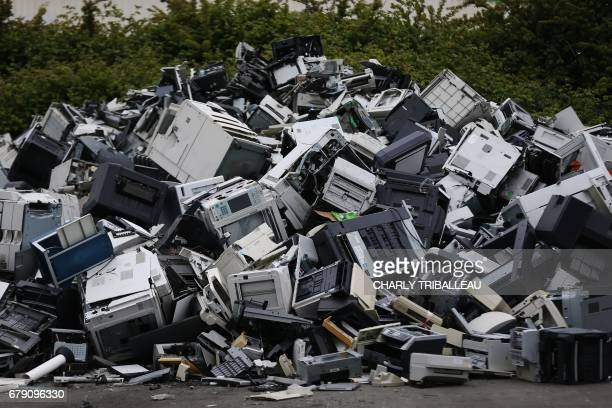 This photo taken on May 3 2017 at Morphosis plant in Le Havre northwestern France shows a pile of discarded electrical and electronic components...