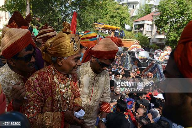 This photo taken on May 30 2015 shows Indian millionaire Indian businessman Bhawarlal Doshi arriving for a religious ceremony on the second day of...