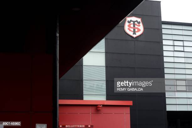 This photo taken on May 30 2017 in Toulouse shows the logo of the Stade Toulousain Rugby club Didier Lacroix formerly the third wing and head of the...