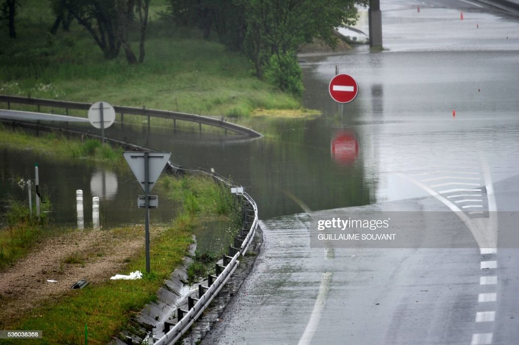 This photo taken on May 31, 2016 in Saran shows the A10 highway, flooded due to heavy rainfalls. The Loiret department is under red flood alert and France's weather agency Meteo France maintained today 18 departments are under orange alert. /