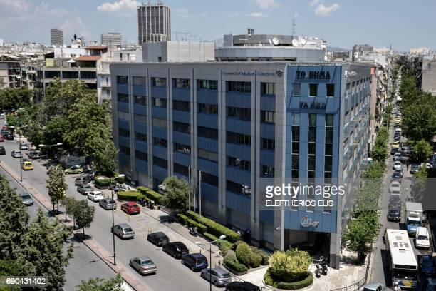 This photo taken on May 31 2017 in Athens shows the building of Lambrakis Press Group Evangelos Marinakis the chief of Greek football powerhouse...