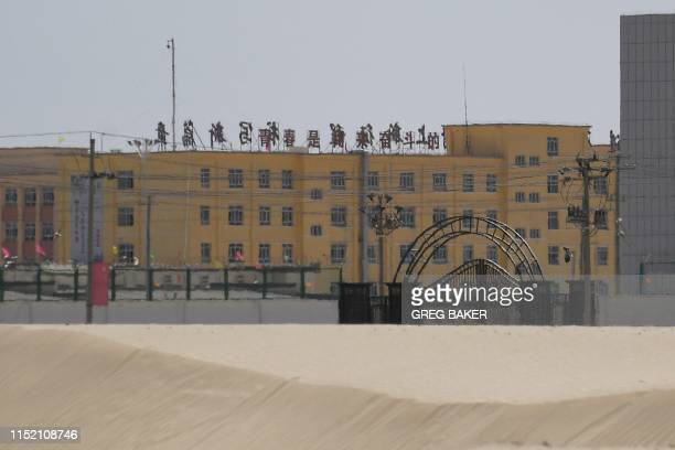 This photo taken on May 31 2019 shows a facility believed to be a reeducation camp where mostly Muslim ethnic minorities are detained on the...