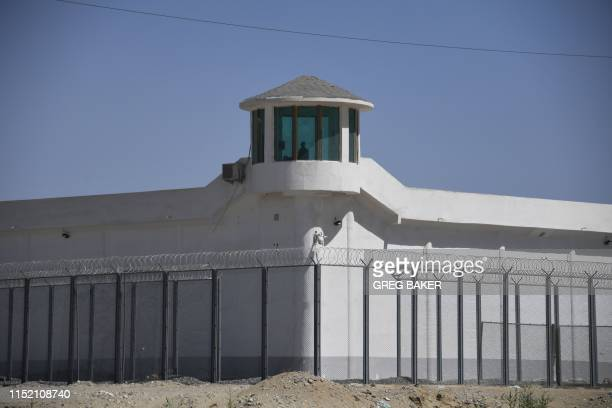TOPSHOT This photo taken on May 31 2019 shows a watchtower on a highsecurity facility near what is believed to be a reeducation camp where mostly...