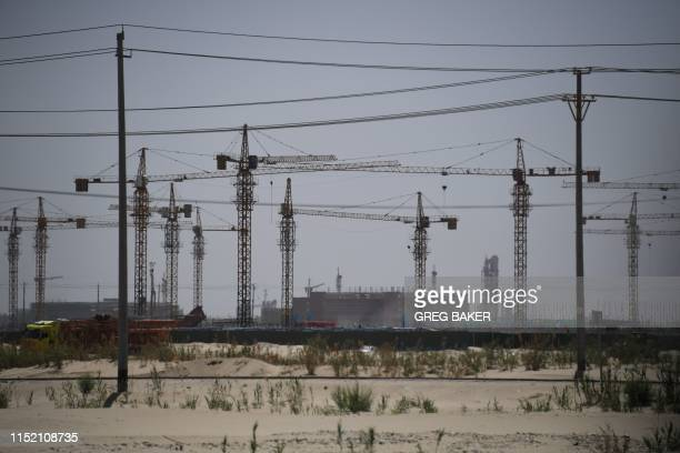 This photo taken on May 31 2019 shows construction sites near a facility believed to be a reeducation camp where mostly Muslim ethnic minorities are...