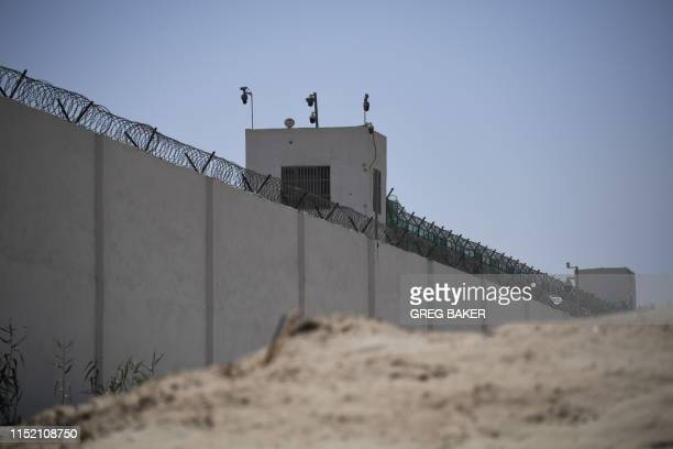 This photo taken on May 31 2019 shows the outer wall of a complex which includes what is believed to be a reeducation camp where mostly Muslim ethnic...