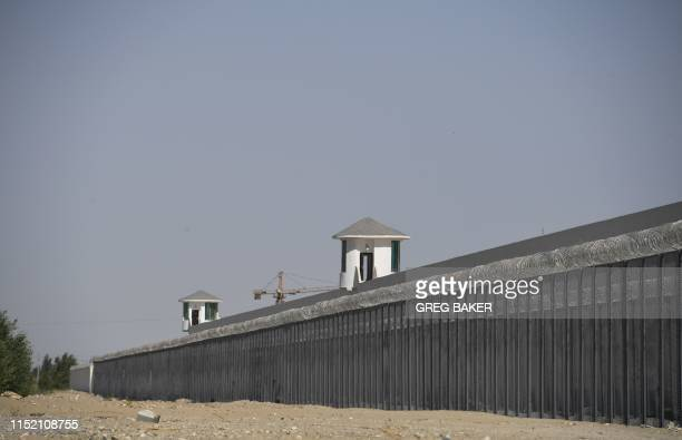 This photo taken on May 31, 2019 shows watchtowers on a high-security facility near what is believed to be a re-education camp where mostly Muslim...