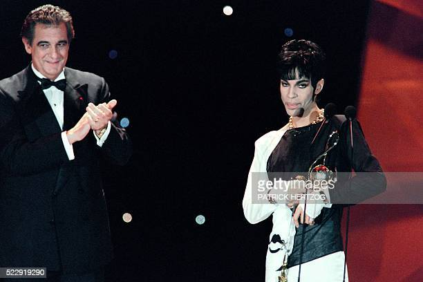 This photo taken on May 4 1994 shows musician Prince acknowledging applause after receiving from Italian tenor Placido Domingo the 'Outstanding...