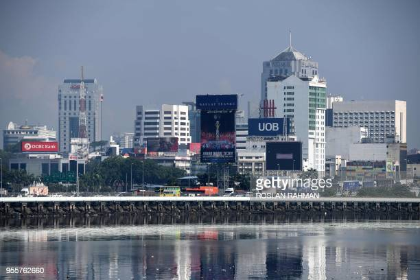 This photo taken on May 4 2018 shows the skyline of the Malaysian city of Johor Bahru is seen across the border from neighbouring Singapore