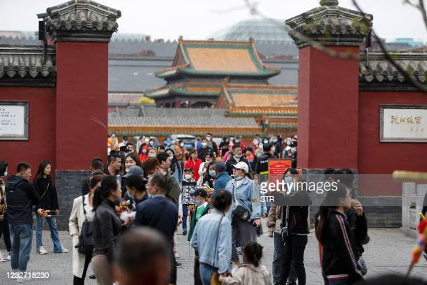 This photo taken on May 4, 2021 shows people visiting the Shenyang Imperial Palace, also known as the Mukden Palace, in Shenyang, in China's Liaoning...
