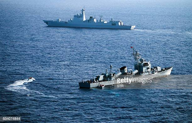 This photo taken on May 5 2016 shows crew members of China's South Sea Fleet taking part in a drill in the Xisha Islands or the Paracel Islands in...