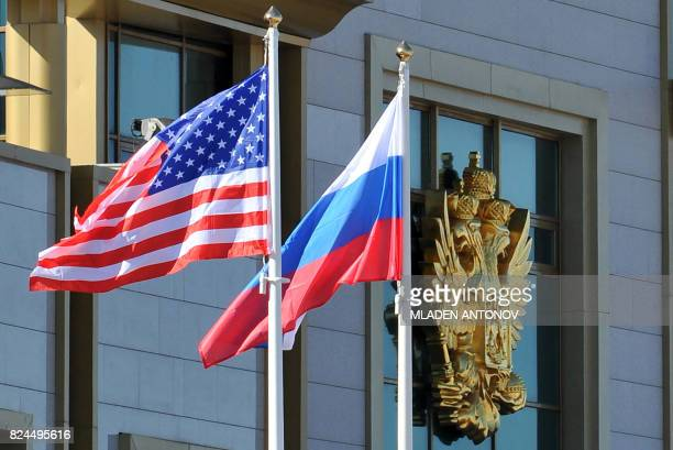 This photo taken on May 7, 2013 shows Russian and the US flags running up as the US Secretary of State arrives at Moscow Vnukovo Airport. Russian...