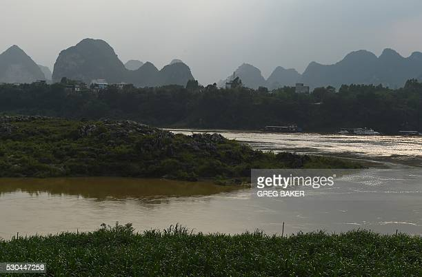 This photo taken on May 8 2016 shows an island in the Qian river where dozens of people were killed in 1968 during the Cultural Revolution in Wuxuan...