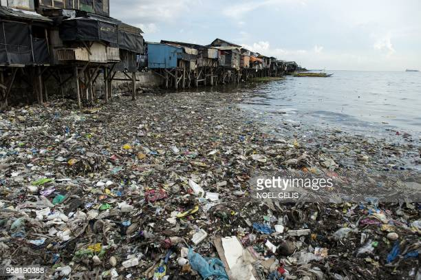 This photo taken on May 9 2018 shows a garbagefilled bay in Manila