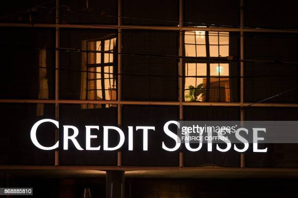 This photo taken on November 1 2017 in Basel shows a branch of Swiss banking giant Credit Suisse / AFP PHOTO / Fabrice COFFRINI