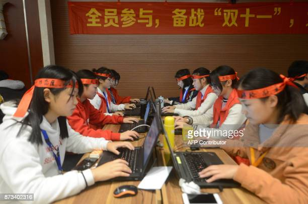 This photo taken on November 11 2017 shows employees of an ecommerce company working overnight for 1111 known as the 'Singles Day' shopping festival...