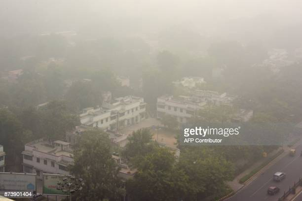 TOPSHOT This photo taken on November 12 2017 shows a general view of heavy smog covering New Delhi Doctors declared a public health emergency in New...