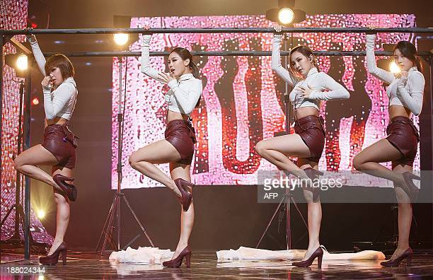 This photo taken on November 14 2013 shows South Korean idol group 'MissA' Fei Jia Min and Suzy performing at Cable TV music program Mnet Countdown...