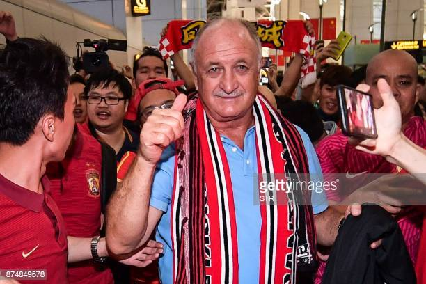 This photo taken on November 15 2017 shows the Brazilian head coach of China's Guangzhou Evergrande club Luiz Felipe Scolari gesturing to the crowd...