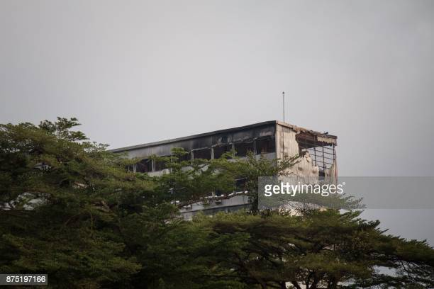 This photo taken on November 17 2017 in Yaounde Cameroon shows the damaged building of Cameroon's parliament after a fire swept through the main...