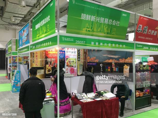 This photo taken on November 17 2017 shows a North Korean trade stand during a sweets and alcohol exhibition in Jinan China's Shandong province While...