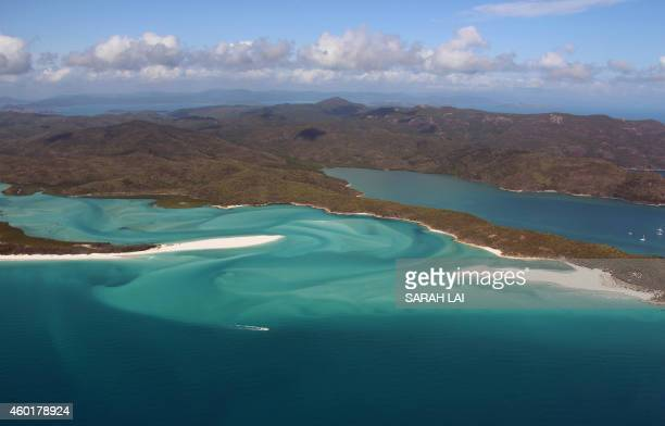 This photo taken on November 20, 2014 shows an aerial view of the Great Barrier Reef off the coast of the Whitsunday Islands, along the central coast...