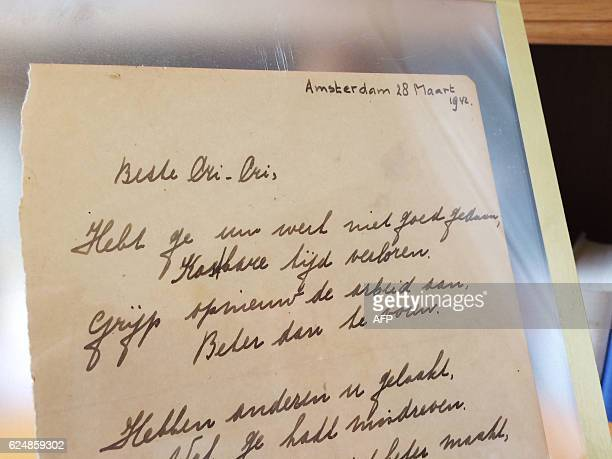 This photo taken on November 21, 2016 at the Bubb Kuyper auction house in Haarlem shows a rare handwritten poem by Anne Frank, penned shortly before...