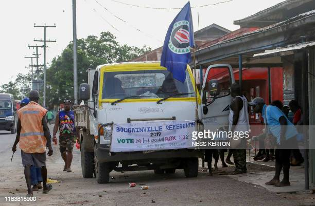 This photo taken on November 21 2019 shows a truck flying the Bougainville flag in the capital Buka ahead of an historical independence vote The...