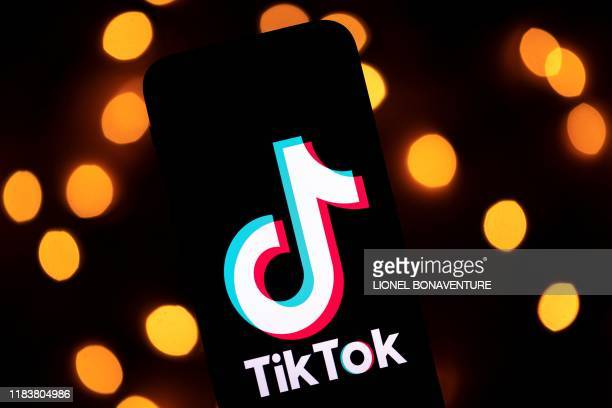 This photo taken on November 21 shows the logo of the social media video sharing app Tiktok displayed on a tablet screen in Paris.