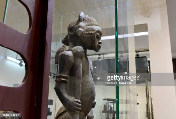 This photo taken on November 22, 2018 shows a statue exhibited at the Civilisation Museum of Abidjan in Ivory Coast. / RESTRICTED TO EDITORIAL USE -...