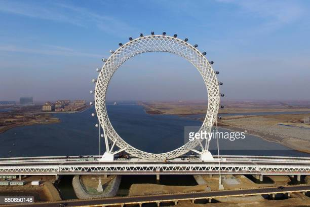 This photo taken on November 27 2017 shows a 145metre high spokeless ferris wheel in Weifang in China's eastern Shandong province The ferris wheel is...