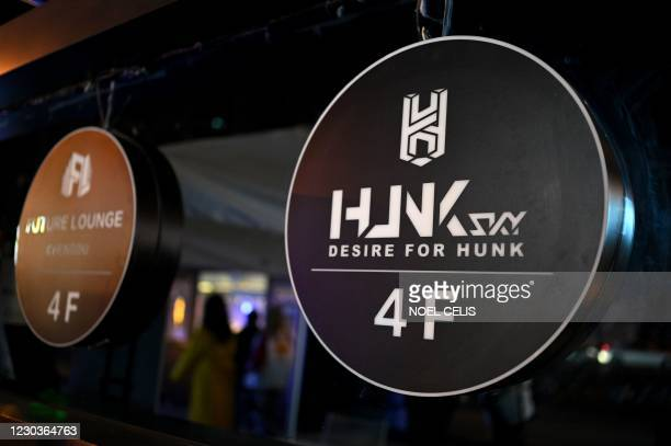This photo taken on November 27, 2020 shows signs in front of the gay bar HUNK in Chengdu, the capital of southwest Sichuan province. - Far from the...