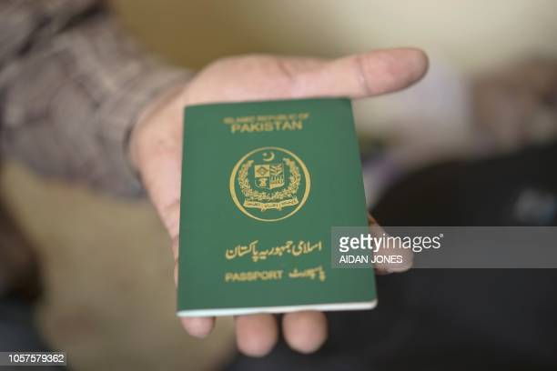 This photo taken on November 3 2018 shows a Pakistani passport of a family member of PakistaniChristian refugees seeking refuge in a small apartment...