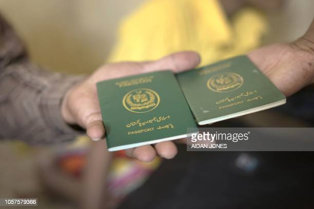 This photo taken on November 3 2018 shows Pakistani passports of family members of PakistaniChristian refugees seeking refuge in a small apartment in...