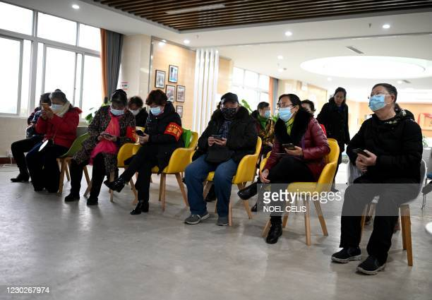 This photo taken on November 30, 2020 shows elderly people attending a training session to get retirees up to speed with digital devices, at the...