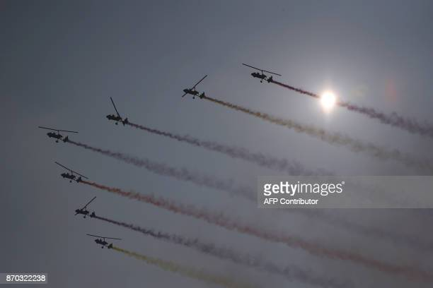 This photo taken on November 4 2017 shows autogyro aircrafts performing during the 2017 FAI World Flyin Expo at Hannan airport in Wuhan in China's...