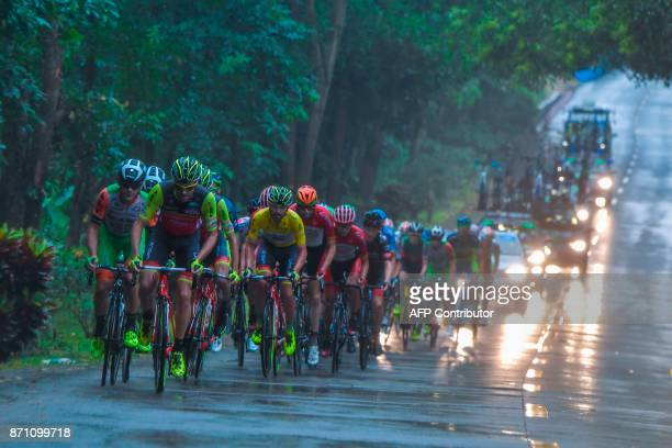 This photo taken on November 4 2017 shows cyclists competing during the 2017 Ring of Hainan international road cycling race in Lingshui in China's...