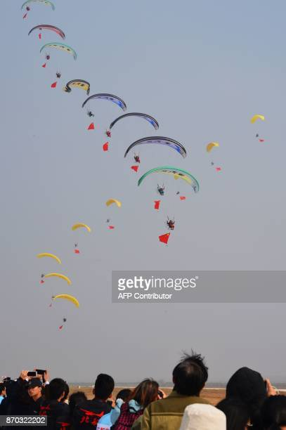 This photo taken on November 4 2017 shows powered parachutists performing during the 2017 FAI World Flyin Expo at Hannan airport in Wuhan in China's...