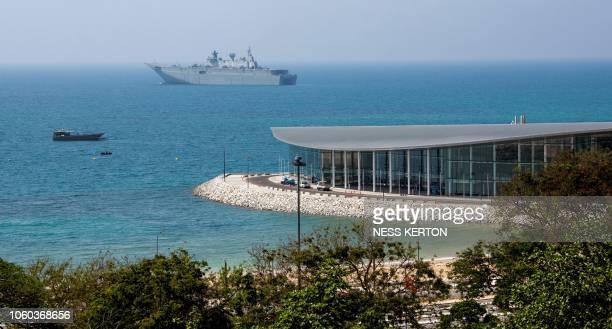 This photo taken on November 4 2018 shows the Australian warship HMAS Adelaide moored off APEC Haus in Port Moresby the host city for the upcoming...