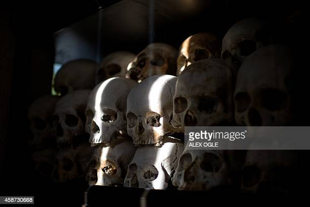 This photo taken on November 5 2014 shows the skulls of victims of the Khmer Rouge regime in a memorial stupa at the Choeung Ek killing fields in...